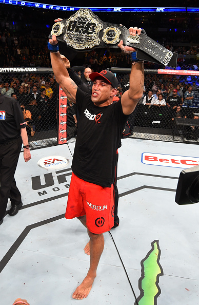 MEXICO CITY, MEXICO - JUNE 13:   Fabricio Werdum of Brazil celebrates his submission victory over Cain Velasquez of the United States in their UFC heavyweight championship bout during the UFC 188 event inside the Arena Ciudad de Mexico on June 13, 2015 in Mexico City, Mexico. (Photo by Josh Hedges/Zuffa LLC/Zuffa LLC via Getty Images)